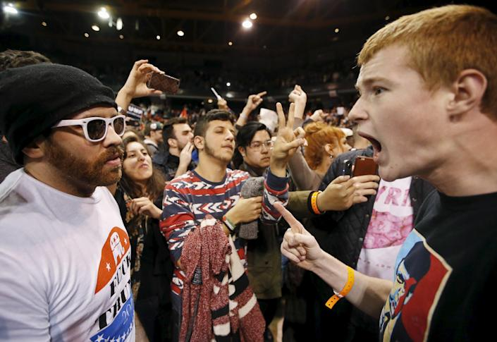 A Trump supporter (R) yells at a demonstrator (L) after Republican U.S. presidential candidate Donald Trump cancelled his rally at the University of Illinois at Chicago March 11, 2016. (REUTERS/Kamil Krzaczynski)