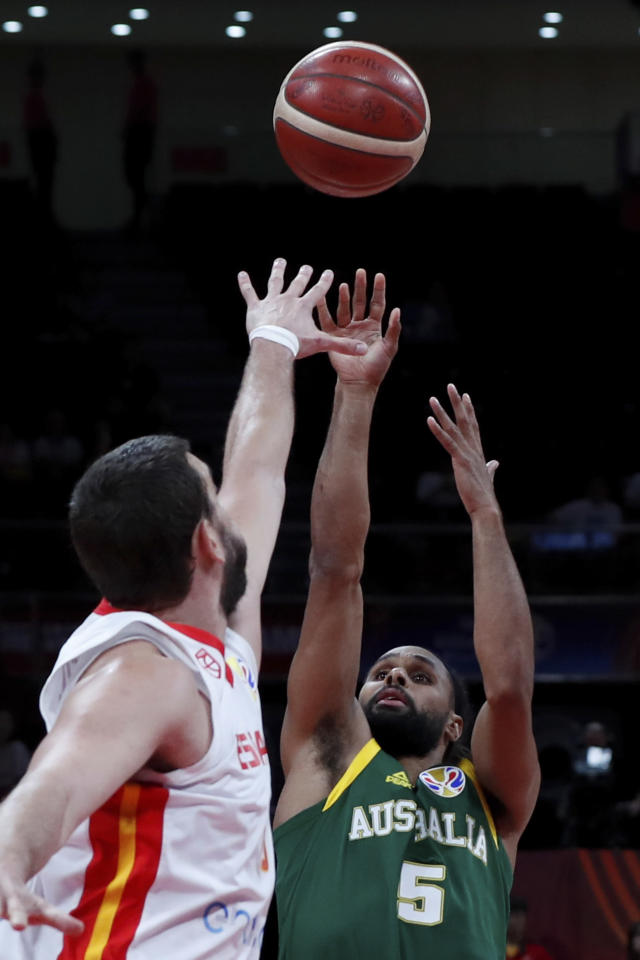Patty Mills of Australia puts a shot over Marc Gasol of Spain during their semifinals match for the FIBA Basketball World Cup at the Cadillac Arena in Beijing, Saturday, Sept. 13, 2019. (AP Photo/Andy Wong)