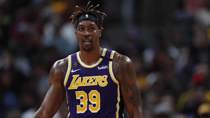 "Lakers center Dwight Howard's first Saturday night back in Orlando was a rather solitary affair. <span class=""copyright"">(David Zalubowski / Associated Press)</span>"