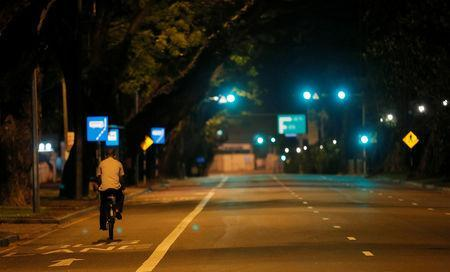 A man rides his bicycle along a road during the curfew after multiple explosions in the country, in Colombo, Sri Lanka April 21, 2019. REUTERS/Dinuka Liyanawatte