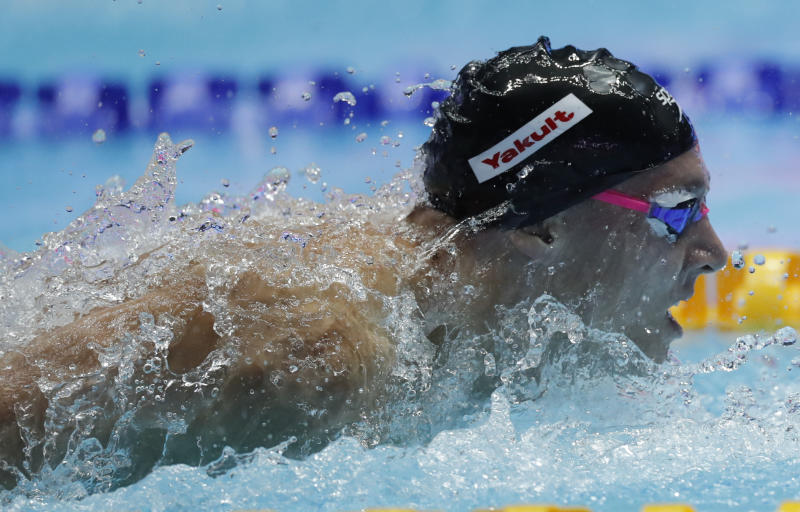 File-This July 27, 2019, file photo shows United States' Caeleb Dressel swimming in the men's 100m butterfly final at the World Swimming Championships in Gwangju, South Korea. In the post-Michael Phelps world, Dressel fits snugly into the successor's slot. Coming off two dynamic performances at the world swimming championships, Dressel figures to be one of the biggest stars at the 2020 Tokyo Games.  Yet he is reticent to step into the spotlight. (AP Photo/Lee Jin-man, File)