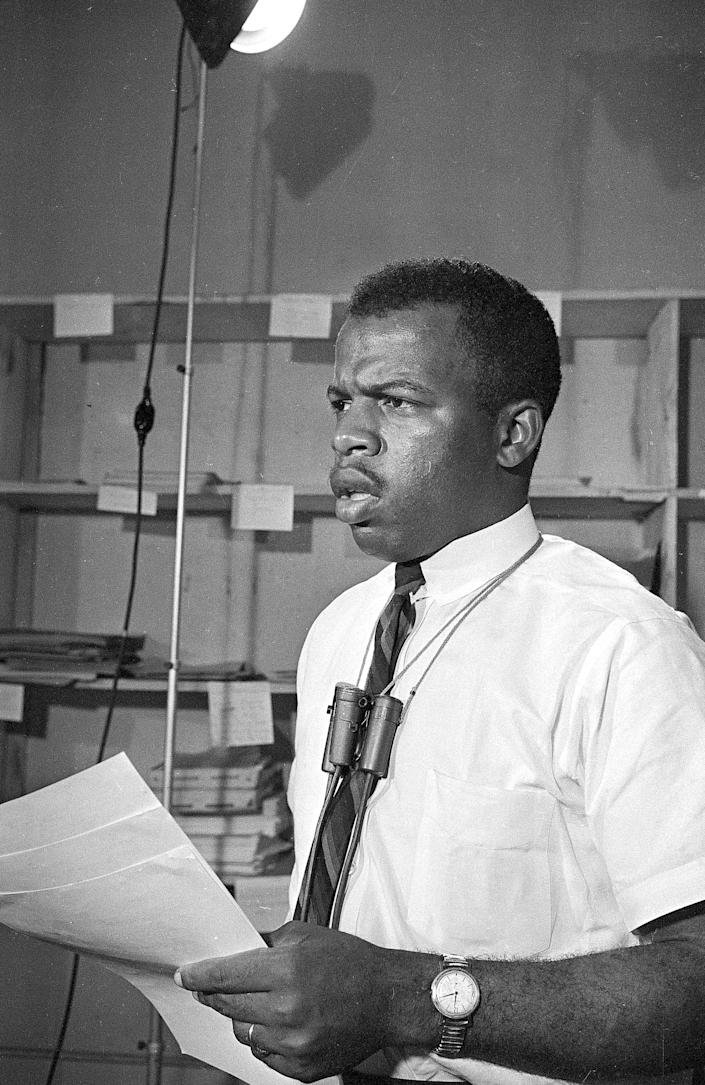 John Lewis speaks in Jackson, Miss., on June 23, 1964, urging President Johnson to protect civil rights workers and volunteers in Mississippi. Two days earlier, Michael Schwerner James Chaney and Andrew Goodman had disappeared.  Their bodies were found in August; they had been tortured and murdered.