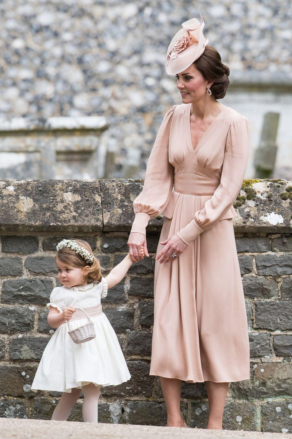 <p>The Duchess wears Alexander McQueen at Pippa Middleton's wedding (along with an adorable Princess Charlotte).</p>