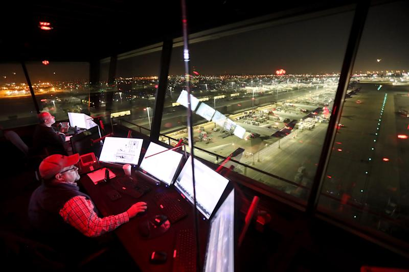 Air Traffic Launch Advisor George Dixon watches tack-off systems from the control tower above the Memphis FedEx super hub on Tuesday, November 20, 2018.