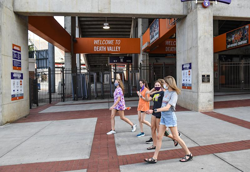 Clemson University's Memorial Stadium in South Carolina is filled with socially distanced fold-up seats set out by volunteers from the athletic department and student organizations.