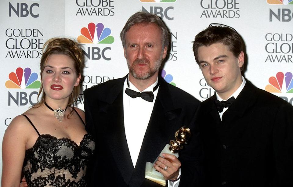<p>The two young stars posed backstage with director James Cameron who won Globes for Best Director and Best Motion Picture, Drama, for <i>Titanic</i>. The film went on to receive the top honor at the Oscars that year, but DiCaprio was famously snubbed in the nominations. (Photo: Jim Smeal/WireImage)</p>
