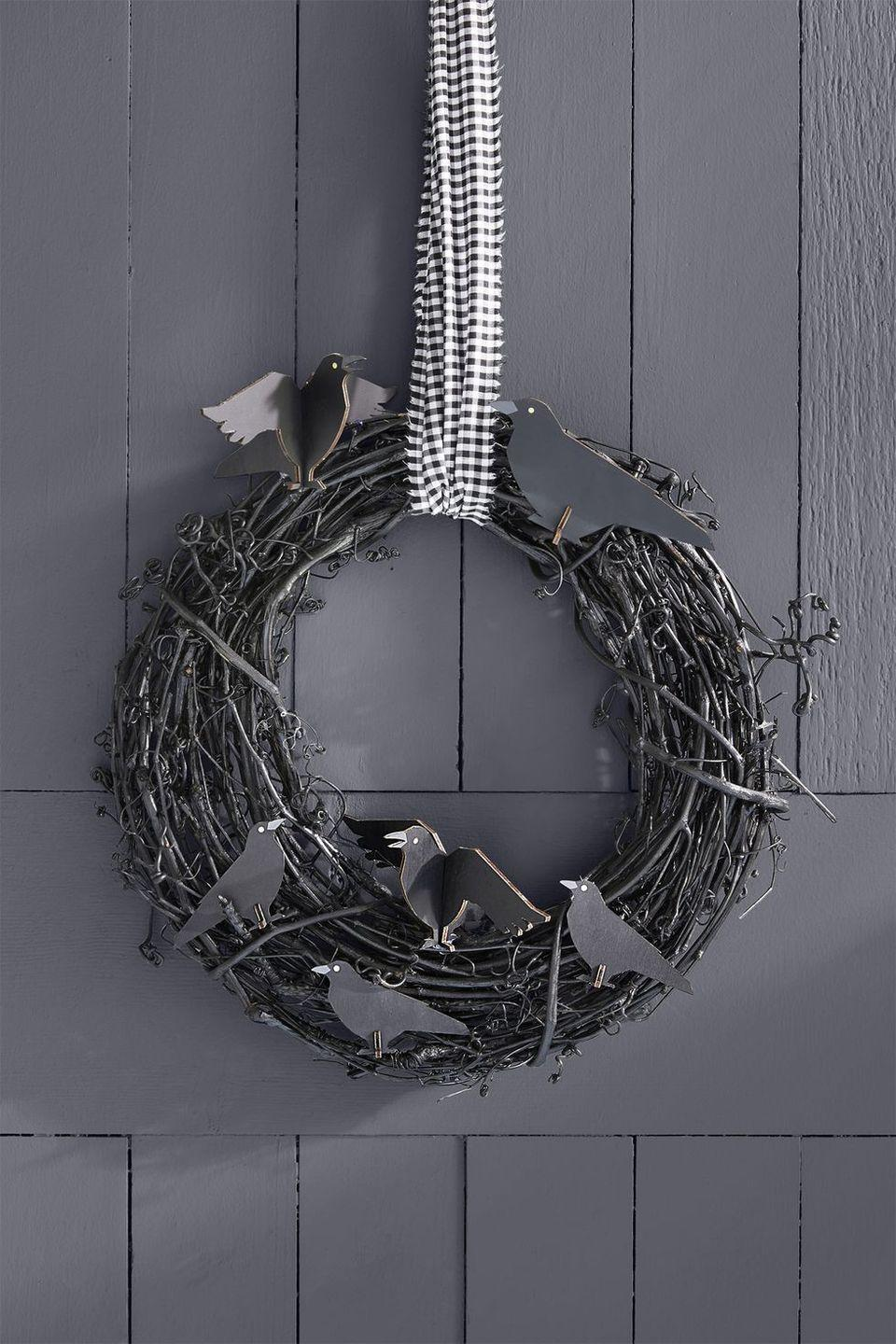 """<p>Make a subtle — but solemn — statement with this all-black wreath. Attach it to your door with a gingham or checkered ribbon for extra pizzazz. </p><p><a class=""""link rapid-noclick-resp"""" href=""""https://www.amazon.com/Darice-GPV10-Grapevine-Wreath-10-Inch/dp/B0054G5PXM/?tag=syn-yahoo-20&ascsubtag=%5Bartid%7C10055.g.421%5Bsrc%7Cyahoo-us"""" rel=""""nofollow noopener"""" target=""""_blank"""" data-ylk=""""slk:SHOP GRAPEVINE WREATHS"""">SHOP GRAPEVINE WREATHS</a></p><p><strong>RELATED:</strong> <a href=""""https://www.goodhousekeeping.com/holidays/halloween-ideas/g4602/outdoor-yard-halloween-decorations/"""" rel=""""nofollow noopener"""" target=""""_blank"""" data-ylk=""""slk:Outdoor Halloween Decorations That'll Steal the Show"""" class=""""link rapid-noclick-resp"""">Outdoor Halloween Decorations That'll Steal the Show </a></p>"""