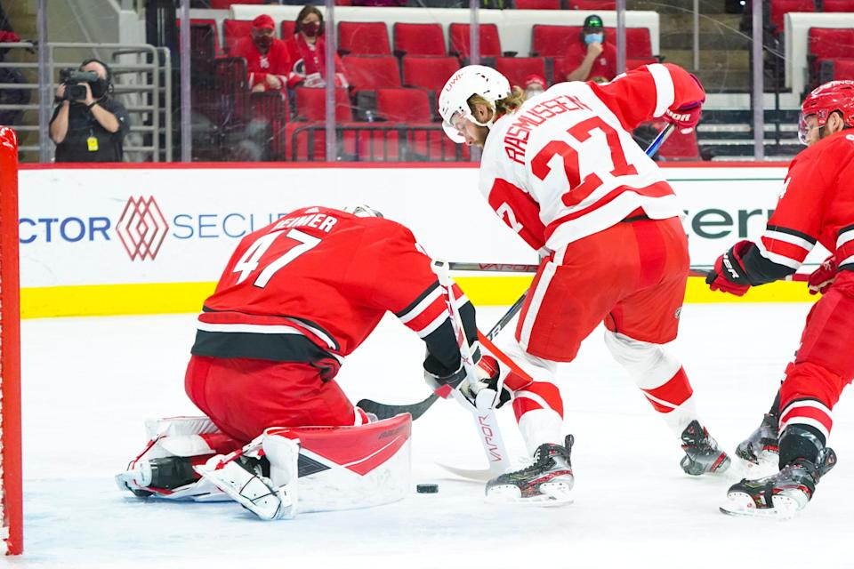 Carolina Hurricanes goaltender James Reimer (47) stops Detroit Red Wings center Michael Rasmussen (27) during the first period April 12, 2021 at PNC Arena.