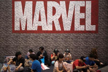 Visitors sit under a Marvel sign at the China International Cartoon and Game (CCG) Expo in Shanghai