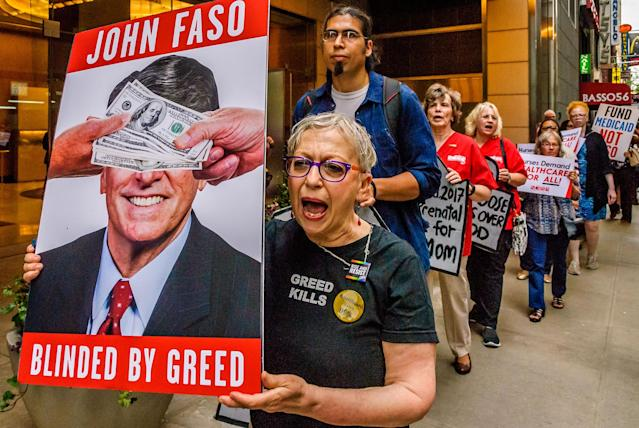 <p>New Yorkers and healthcare advocacy groups organized a protest on July 10, 2017, outside Rep. John Faso's fundraiser as donors arrive at the Park Imperial at 230 West 56th St. in Midtown Manhattan. Faso voted for the House Trumpcare bill in May, he also co-authored the notorious Collins-Faso amendment to both the House and Senate bills that would shift New York Medicaid funding from counties budgets to the state budget. (Photo: Erik McGregor/Pacific Press/LightRocket via Getty Images) </p>