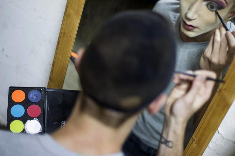 Drag queen Glory Hollywood applies make-up before a drag show in Tel Aviv