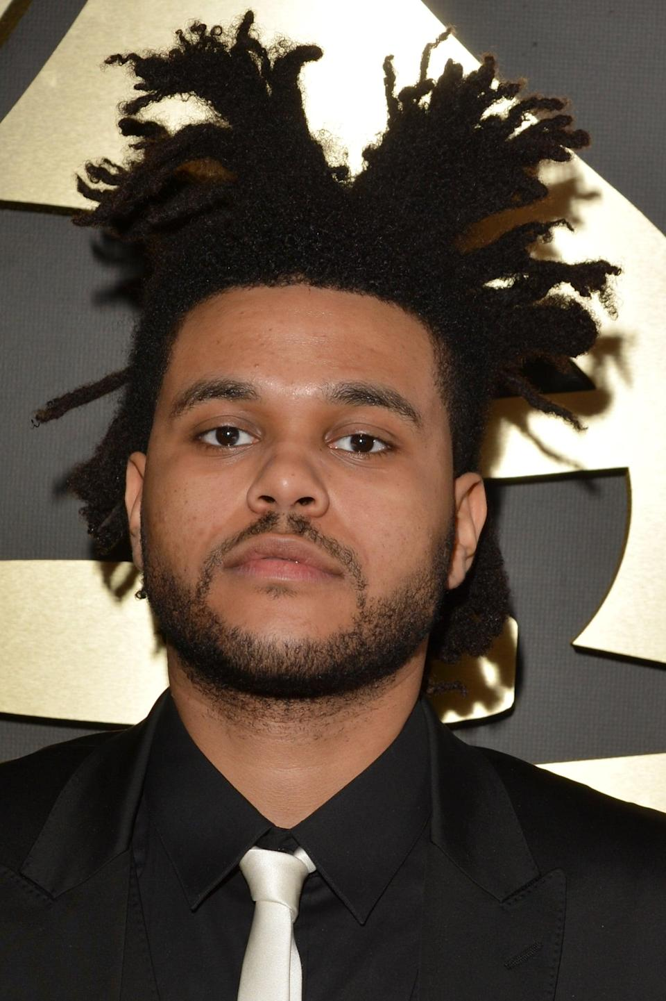 <p>By 2014, the locs became a key part of his look.</p>