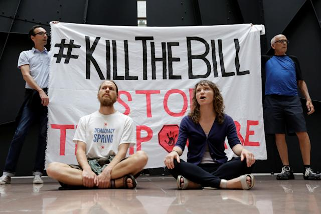 Health care activists protest to stop the Republican health care bill at Hart Senate Office Building on Capitol Hill on July 17, 2017.