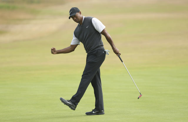 Tiger Woods capped a three-under front nine with a long birdie putt. (AP Photo/Peter Morrison)
