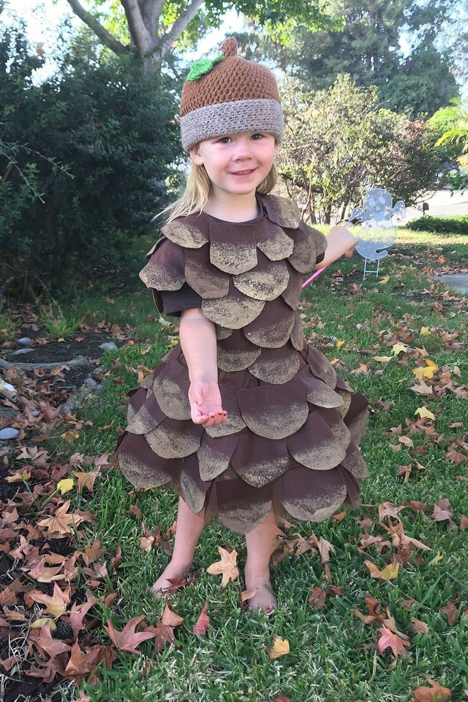 "<p>This <a href=""https://nuggetlands.com/pine-cone-halloween-costume-diy/"" rel=""nofollow noopener"" target=""_blank"" data-ylk=""slk:little pine cone creation"" class=""link rapid-noclick-resp"">little pine cone creation</a> is perfect for Halloween or just anyone who is <em>really</em> into fall. </p>"