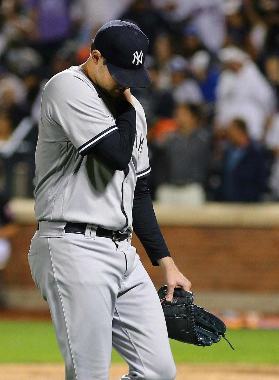 New York Yankees starting pitcher Jordan Montgomery leaves the mound after being taken out of the game in the fourth inning after giving up seven runs against the Mets.