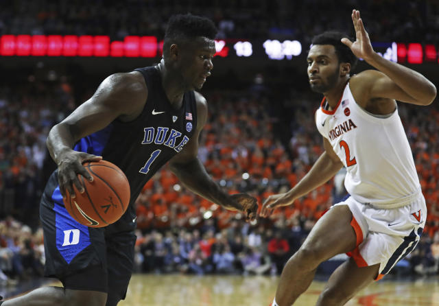 Duke forward Zion Williamson (1) drives past Virginia's guard Braxton Key during the first half of an NCAA college basketball game Saturday, Feb. 9, 2018, in Charlottesville, Va. (AP Photo/Zack Wajsgras)