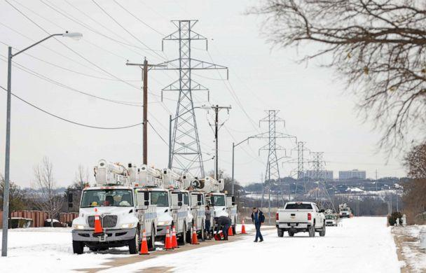 PHOTO: Pike Electric service trucks line up after a snow storm on Feb. 16, 2021 in Fort Worth, Texas. Winter storm Uri has brought historic cold weather and power outages to Texas.  (Ron Jenkins/Getty Images)