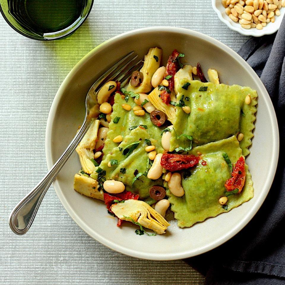 """<p>Store-bought spinach ravioli and a handful of basic pantry items are all you need to get a healthy dinner on the table in 15 minutes. Ingredients like oil-packed sun-dried tomatoes, briny Kalamata olives and toasty pine nuts help to build big flavor fast. If you can't find frozen artichokes, swap in a 15-ounce can (just be sure to drain and rinse them well). <a href=""""http://www.eatingwell.com/recipe/274008/mediterranean-ravioli-with-artichokes-olives/"""" rel=""""nofollow noopener"""" target=""""_blank"""" data-ylk=""""slk:View recipe"""" class=""""link rapid-noclick-resp""""> View recipe </a></p>"""