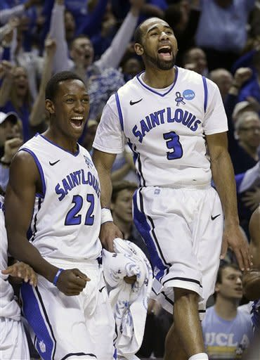 Saint Louis forward Jared Drew (22) and guard Kwamain Mitchell (3) celebrate on the bench during the second half of a second-round game in the NCAA college basketball tournament against New Mexico State in San Jose, Calif., Thursday, March 21, 2013. Saint Louis won 64-44. (AP Photo/Jeff Chiu)
