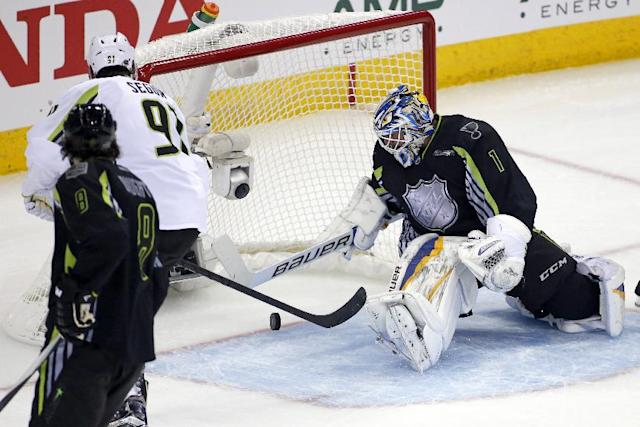 Team Toews' Tyler Seguin (91) of the Dallas North Stars doesn't get the goal as Team Foligno goalie Brian Elliott (1) of the St. Louis Blues falls on top of the puck during the third period of the NHL All-Star hockey game in Columbus, Ohio, Sunday, Jan. 25, 2015. Team Toews won 17-12. (AP Photo/Gene J. Puskar)