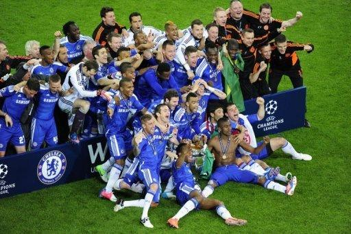 Chelsea players celebrate with the trophy winning the Champions League final against Bayern Munich at the Allianz Arena in Munich on May 19. Chelsea beat Bayern Munich 4-3 on penalties after the game finished 1-1 after extra-time