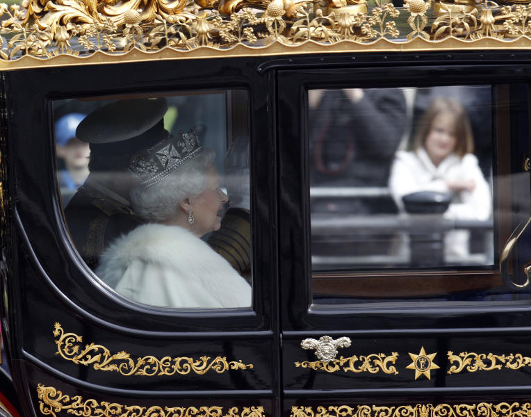 Britain's Queen Elizabeth II departs from Buckingham Palace on her way to the Houses of Parliament for the State Opening of Parliament, in London, Wednesday, May 9, 2012. From a gilded throne in the House of Lords the queen will read aloud the British Government's annual legislative package in traditionally opulent style.(AP Photo/Lefteris Pitarakis)