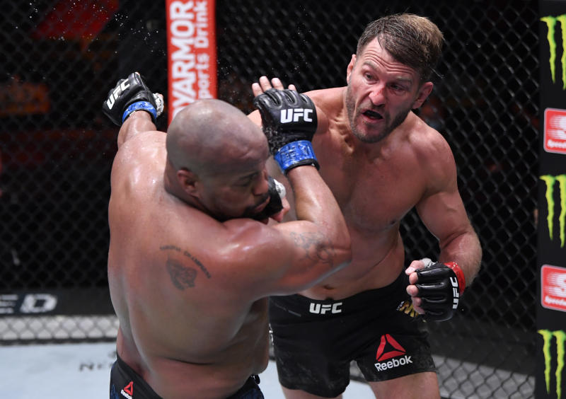LAS VEGAS, NEVADA - AUGUST 15: (R-L) Stipe Miocic punches Daniel Cormier in their UFC heavyweight championship bout during the UFC 252 event at UFC APEX on August 15, 2020 in Las Vegas, Nevada. (Photo by Jeff Bottari/Zuffa LLC)