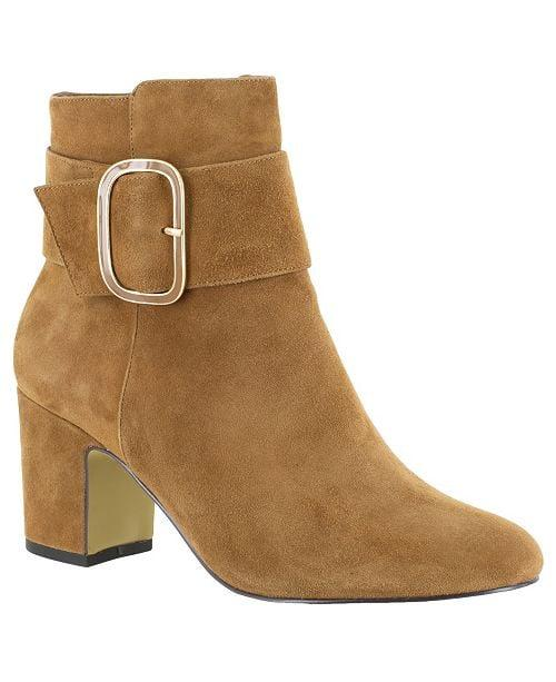 """<p>These <a href=""""https://www.popsugar.com/buy/Bella-Vita-Klaire-Ankle-Booties-498306?p_name=Bella%20Vita%20Klaire%20Ankle%20Booties&retailer=macys.com&pid=498306&price=120&evar1=fab%3Aus&evar9=46720231&evar98=https%3A%2F%2Fwww.popsugar.com%2Fphoto-gallery%2F46720231%2Fimage%2F46720244%2FBella-Vita-Klaire-Ankle-Booties&list1=shopping%2Cfall%20fashion%2Cshoes%2Cboots%2Cfall%2Cfall%20shoes%2Cmacys%2Cwide%20feet&prop13=api&pdata=1"""" rel=""""nofollow"""" data-shoppable-link=""""1"""" target=""""_blank"""" class=""""ga-track"""" data-ga-category=""""Related"""" data-ga-label=""""https://www.macys.com/shop/product/bella-vita-klaire-ankle-booties?ID=10172626&amp;CategoryID=25122&amp;sizes=WOMEN_SHOE_WIDTH_SIZE_T!!Wide;;Extra%20Wide#fn=SIZE%3DWOMEN_SHOE_WIDTH_SIZE_T%3AWide%7CExtra%20Wide"""" data-ga-action=""""In-Line Links"""">Bella Vita Klaire Ankle Booties</a> ($120) look so sophisticated.</p>"""