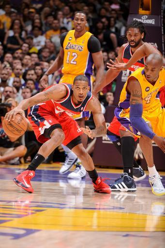 LOS ANGELES, CA - MARCH 22: Trevor Ariza #1 of the Washington Wizards drives against Kobe Bryant #24 of the Los Angeles Lakers at Staples Center on March 22, 2013 in Los Angeles, California. (Photo by Andrew D. Bernstein/NBAE via Getty Images)