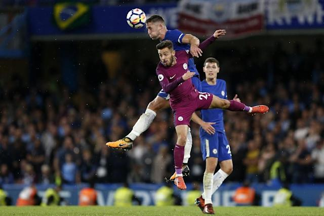 Chelsea's Gary Cahill wins a header from Manchester City's Bernardo Silva during their match at Stamford Bridge in London on September 30, 2017 (AFP Photo/Ian KINGTON)