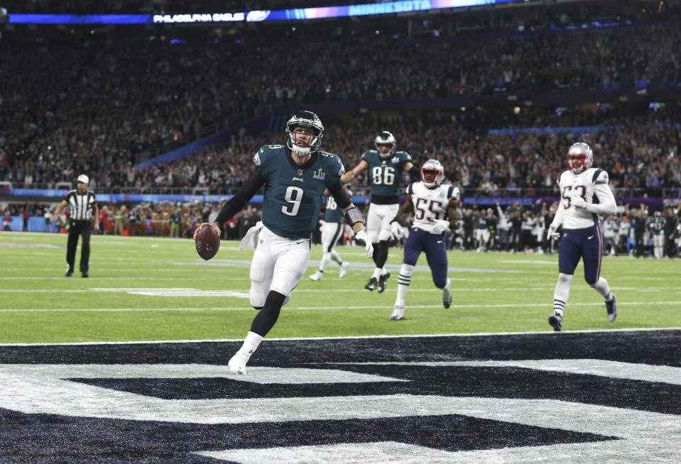 Philadelphia Eagles quarterback Nick Foles catches a touchdown pass from tight end Trey Burton, background, in the second quarter against the New England Patriots in Super Bowl LII. (AP)