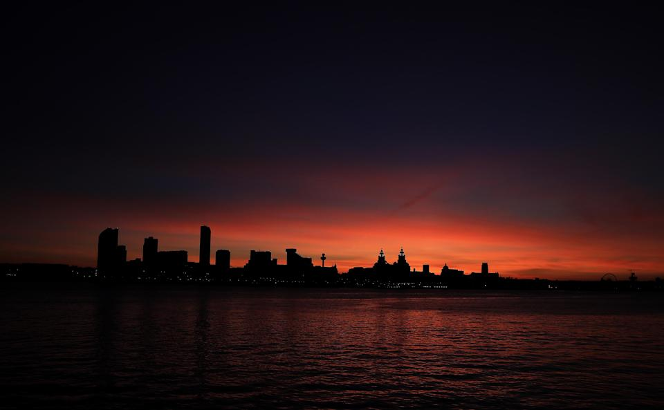 <p>A view of the River Mersey and the city skyline as the sun rises over Liverpool. (PA) </p>