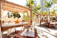 "<p>This famed beach club has been popping bottles on South Beach since 1998, when it ruled the Miami scene and hosted big names like Madonna and Leonardo DiCaprio for epic nights of partying. But as South Beach matured beyond its wild nightlife persona, so did <a href=""https://miami-beach.nikkibeach.com"" rel=""nofollow noopener"" target=""_blank"" data-ylk=""slk:Nikki Beach"" class=""link rapid-noclick-resp"">Nikki Beach</a>; and nowadays, the club plays out as a fabulous daytime affair focused on the luxe beach lifestyle and the <em>joie de vivre</em> found therein. Rent a daybed or reserve a table for a toes-in-the-sand afternoon filled with plenty of Champagne, rosé, sushi boats, house music, and incredible people watching.</p> <p><strong>Who it's best for:</strong> Friends and couples with a penchant for day-drinking</p> <p><strong>The vibe:</strong> Miami flash with some St. Tropez panache</p> <p><strong>What to do:</strong> Drink, dance, repeat</p>"