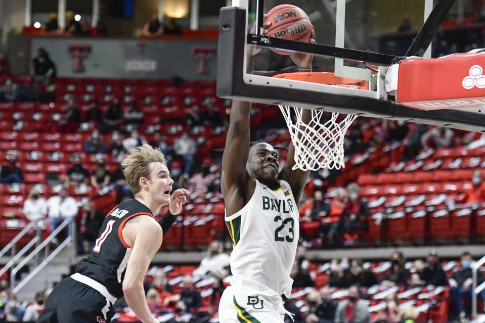 Baylor's Jonathan Tchatchoua (23) dunks the ball during the second half of an NCAA college basketball game against Texas Tech in Lubbock, Texas, Saturday, Jan. 16, 2021. (AP Photo/Justin Rex)