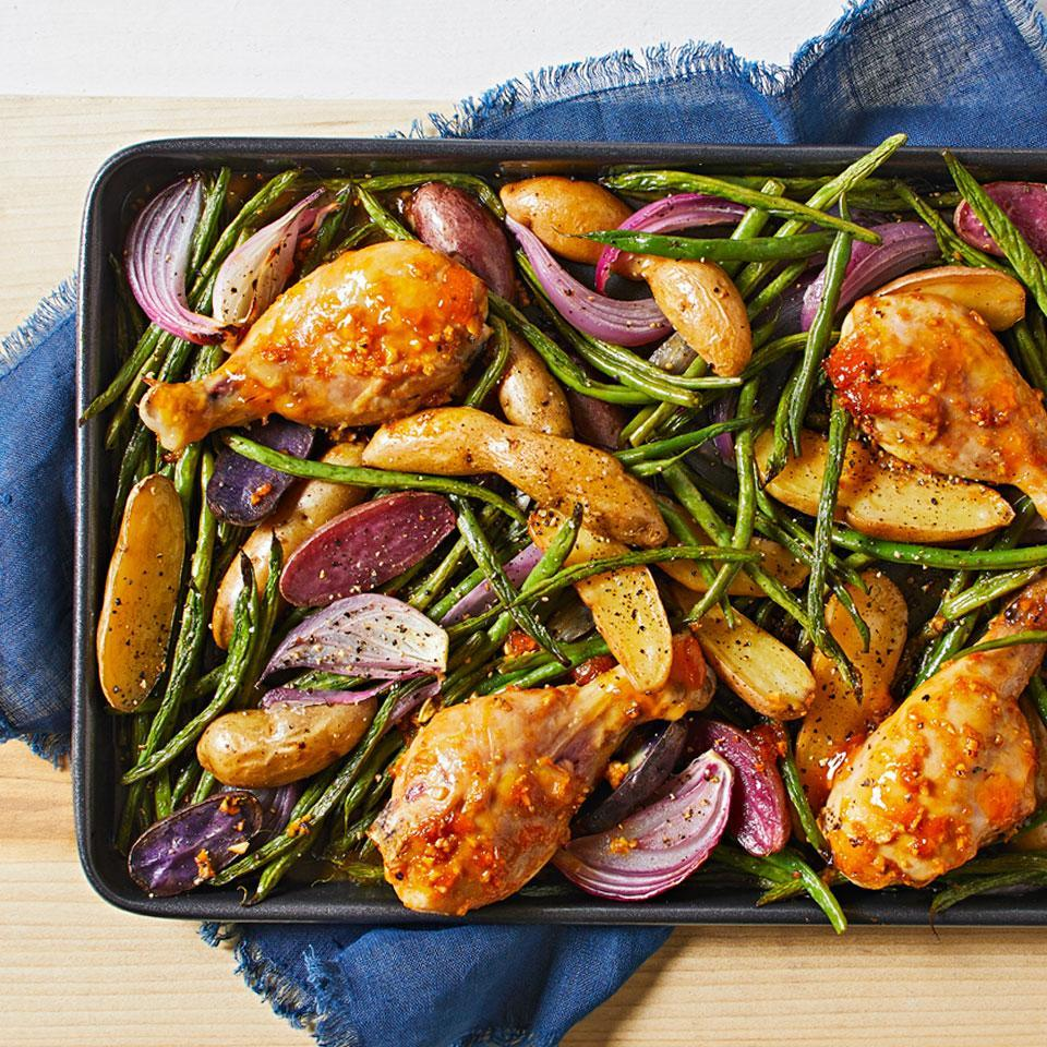 <p>In this easy sheet-pan dinner, a sweet-and-savory glaze and a colorful medley of vegetables transform ordinary drumsticks into a satisfying meal.</p>