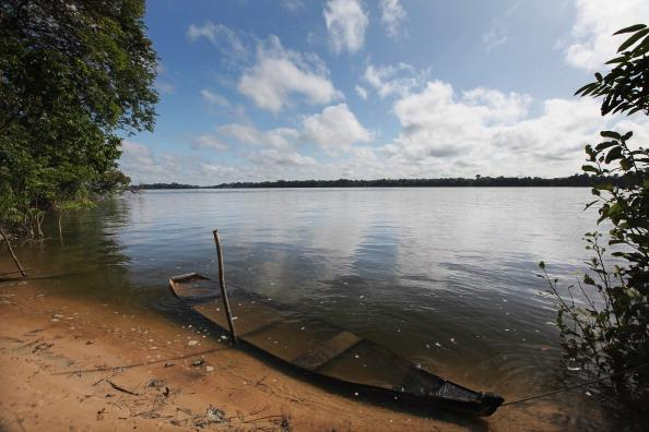 An old boat is submerged in the Xingu River near the site where the Belo Monte dam complex is under construction in the Amazon basin on June 14, 2012 near Altamira, Brazil. Belo Monte will be the world's third-largest hydroelectric project and will displace up to 20,000 people while diverting the Xingu River and flooding as much as 230 square miles of rainforest. Mario Tama/Getty Images