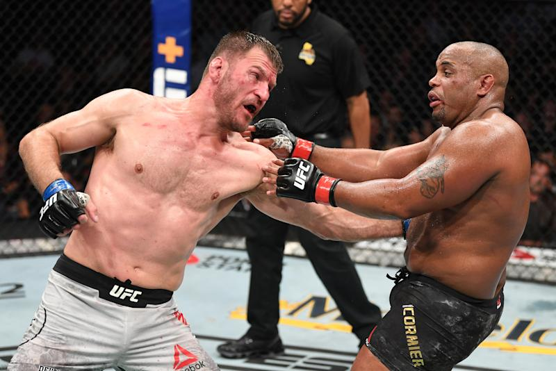 ANAHEIM, CALIFORNIA - AUGUST 17: (L-R) Stipe Miocic punches Daniel Cormier in their heavyweight championship bout during the UFC 241 event at the Honda Center on August 17, 2019 in Anaheim, California. (Photo by Josh Hedges/Zuffa LLC/Zuffa LLC via Getty Images)
