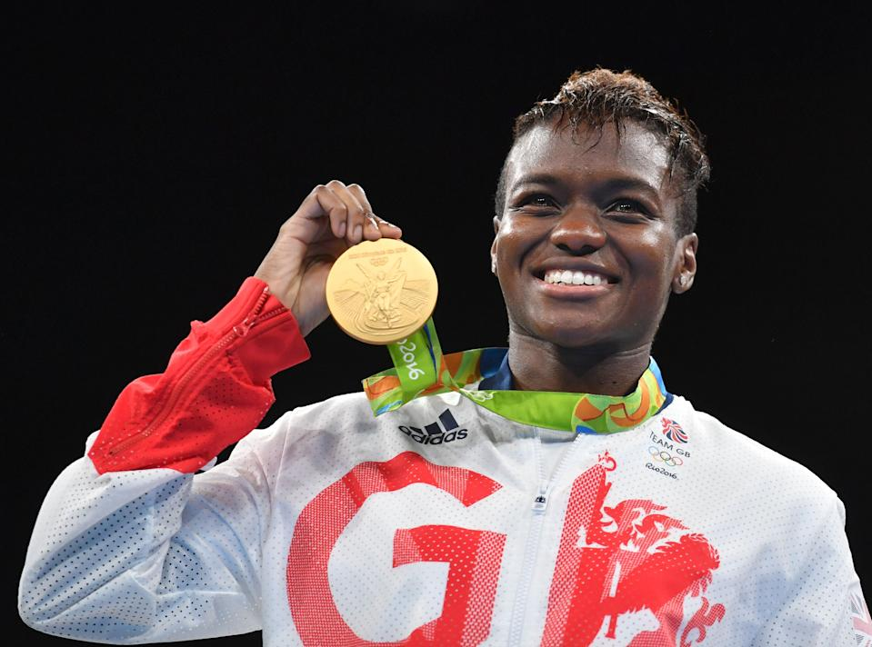 Great Britain's Nicola Adams poses on the podium with a gold medal during the Rio 2016 Olympic Games at the Riocentro - Pavilion 6 in Rio de Janeiro on August 20, 2016.   / AFP / Yuri CORTEZ        (Photo credit should read YURI CORTEZ/AFP/Getty Images)
