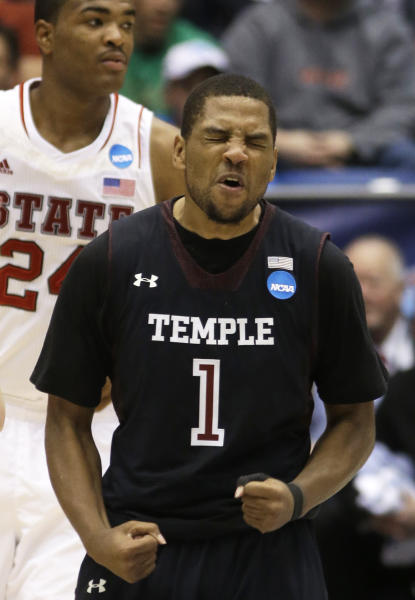 Temple guard Khalif Wyatt (1) celebrates after making the game-clinching free throws in the closing seconds of the second half against North Carolina State in a second-round game at the NCAA college basketball tournament, Friday, March 22, 2013, in Dayton, Ohio. Wyatt led Temple to a 76-72 win with 31 points. (AP Photo/Al Behrman)