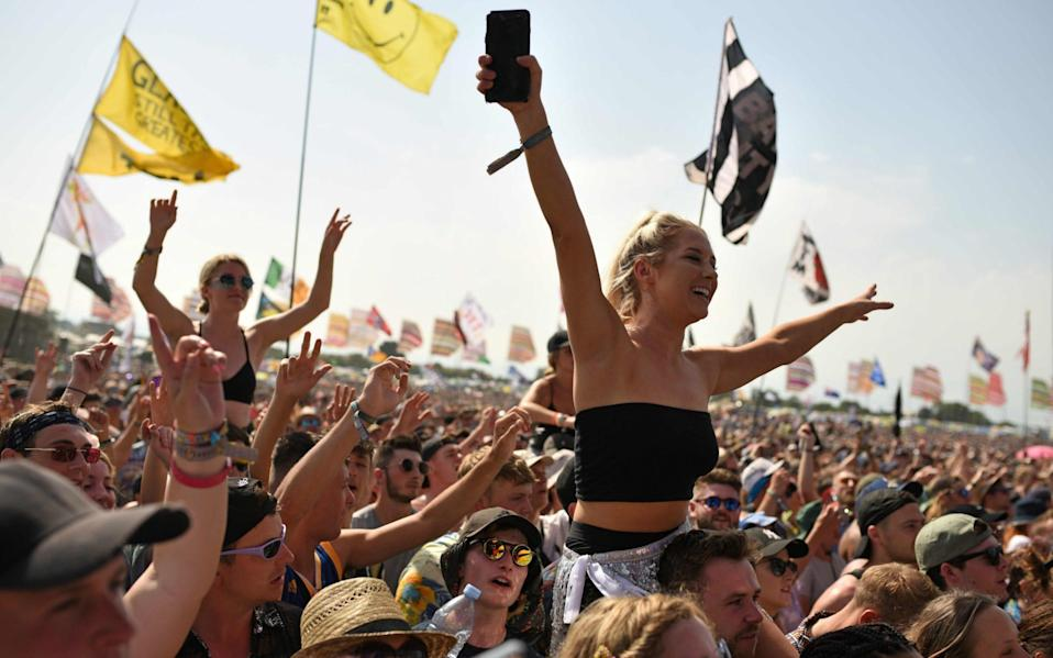 Revellers enjoy the performance of Scottish singer song-writer Lewis Capaldi at the Glastonbury Festival of Music and Performing Arts on Worthy Farm near the village of Pilton in Somerset, South West England, on June 29, 2019. - AFP