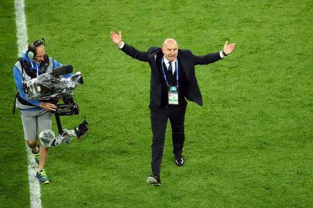 Soccer Football - World Cup - Group A - Russia vs Egypt - Saint Petersburg Stadium, Saint Petersburg, Russia - June 19, 2018 Russia coach Stanislav Cherchesov celebrates after the match REUTERS/Michael Dalder