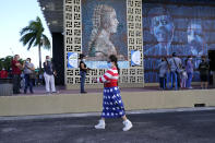 Yanitza Martinez wears red, white, and blue as she arrives to vote outside of the John F. Kennedy Library during the general election, Tuesday, Nov. 3, 2020, in Hialeah, Fla. (AP Photo/Lynne Sladky)