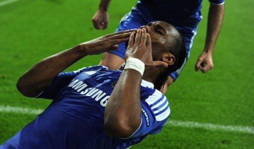 Chelsea's forward Didier Drogba celebrates after scoring a goal during their UEFA Champions League final football against Bayern Munich at Fussball Arena stadium in Munich. Chelsea beat Bayern Munich 4-3 on penalties to win the Champions League on Saturday after the two sides had been locked at 1-1 at the end of extra-time