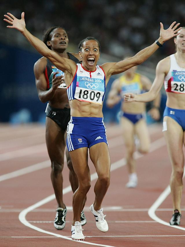 ATHENS - AUGUST 23: Kelly Holmes of Great Britain celebrates after she won gold in the women's 800 metre final on August 23, 2004 during the Athens 2004 Summer Olympic Games at the Olympic Stadium in the Sports Complex in Athens, Greece. (Photo by Stu Forster/Getty Images)