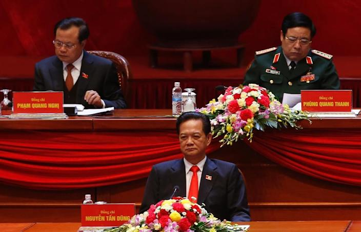 Prime Minister Nguyen Tan Dung (C) attends the opening ceremony of the 12th National Congress of Vietnam's Communist Party, in front Hanoi City's Party Chief Pham Quang Nghi (L) and Defence Minister Phung Quang Thanh, in Hanoi, on January 21, 2016 (AFP Photo/KHAM)