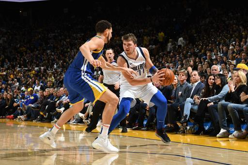 OAKLAND, CA - MARCH 23: Luka Doncic #77 of the Dallas Mavericks looks to shoot step-back three against the Golden State Warriors on March 23, 2019 at ORACLE Arena in Oakland, California. (Photo by Noah Graham/NBAE via Getty Images)