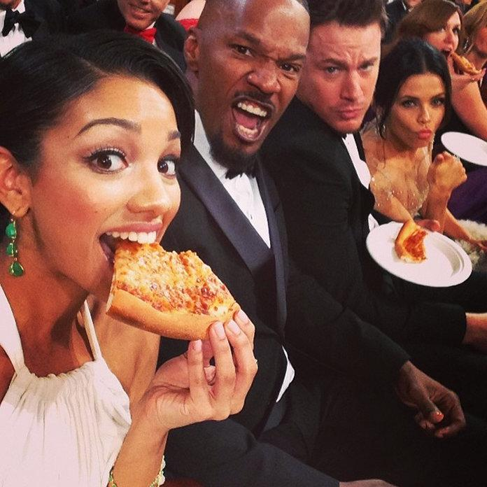 The hottest red carpet accessory of late? A good slice of thin crust. Just remember to let it cool down first.  From Kendall and Kylie Jenner's chic Golden Globes snack sesh to Selena Gomez's recent #pizzagram, stars are proving that they're down for much more than a green juice, even during awards season.  In honor of National Pizza Day, we're looking back at the celebs who mix carbs with their couture and give a whole new meaning to the word fancy feast.  RELATED: Pizza ATMs Are Coming &