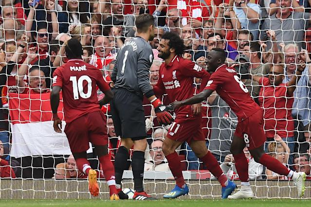 Naby Keita (right), Mohamed Salah and Sadio Mane celebrate Liverpool's first goal of the 2018-19 Premier League season. (Getty)
