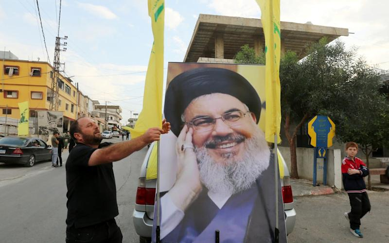 Hassan Nasrallah urged his followers to stay away from the protests after they clashed with demonstrators in Beirut.   - REUTERS